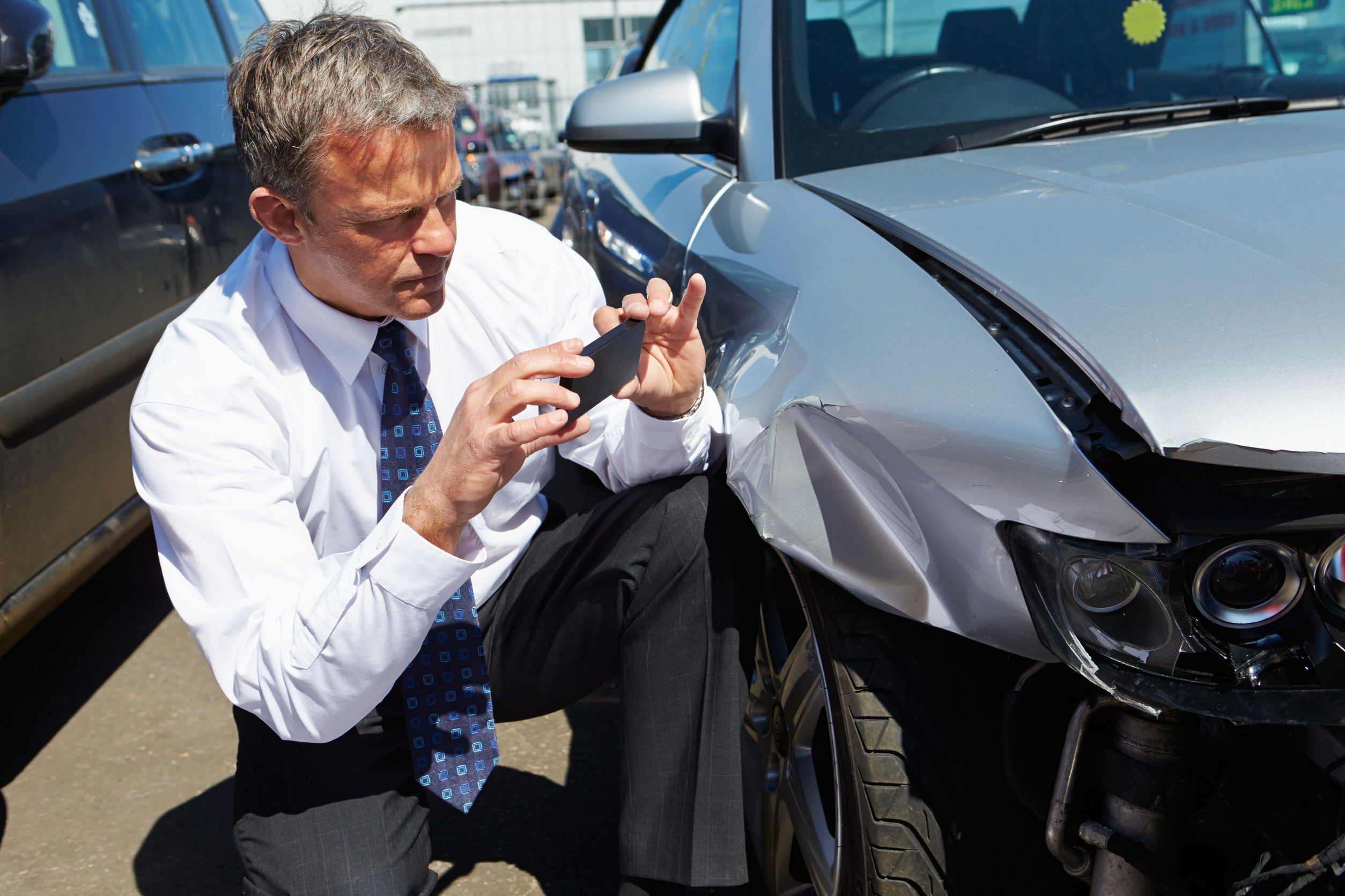 28154298 - loss adjuster inspecting car involved in accident